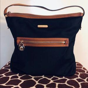 Michael Kors black and tan purse